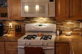 glass mosaic kitchen backsplash white and dark cabinets kitchens