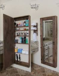 Bathroom Mirror Storage by How To Hang Mirrors U0026 Pictures On Plaster Walls Without Nails