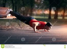 fitness man doing a bench press up outside stock photo image