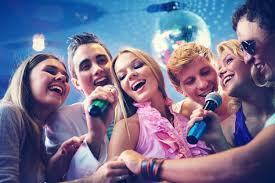 happy friends singing karaoke together photo free