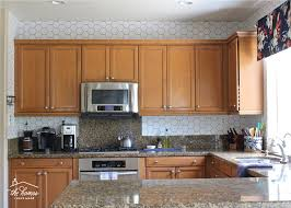 what backsplash goes with brown cabinets how to wallpaper a backsplash the homes i made