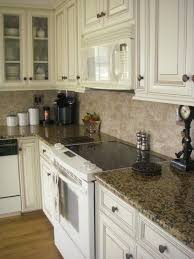 giallo fiorito granite with oak cabinets off white distressed kitchen cabinets home design ideas