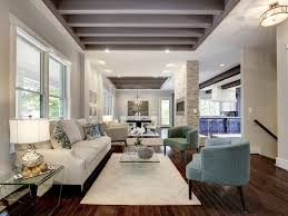 living room painted ceiling beams nice blue accent chairs nice