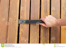 removing old wooden boards with pry bar stock photo image 40760153