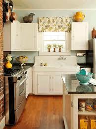 plain white kitchen cabinet dark brown granite countertop steel