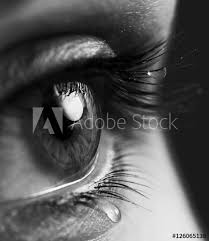 tears on open expressive look with teardrop on the