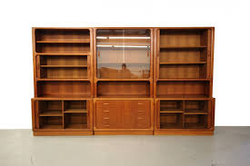 set of three danish teak wall unit bookcase shelving by dyrlund at