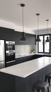 white kitchen cupboards black bench black and white kitchen bosch appliances absolute matte