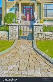 nicely paved doorway house entrance landscape stock photo