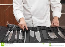 chef selecting knife sharpener out of full set stock images