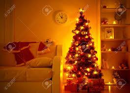 Lighted Christmas Trees Lighted Christmas Tree With Presents Underneath In Living Room