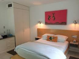 bed and closet from front door picture of kimber modern hotel