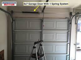 garage door bottom bracket garage door torsion vs extension springs which one is better