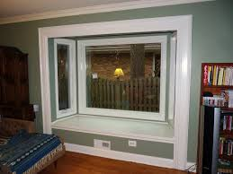 futuristic style window seating design with green paint frames