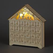 wood advent calendar carved wooden advent calendar with illuminated christmas scenery