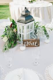 wedding reception centerpieces of a lantern floral and herb