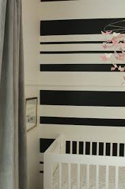 diy black white stripe wall house to home blog when first starting to plan the nursery i was looking at colors and nothing was really catching my eye i knew i wanted an all white room with an accent