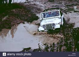 jeep mud jeep crossing a mud and water bad road conditions stuck off road
