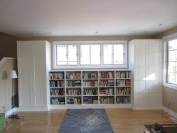 living room built in bookshelves and closets using besta shelves