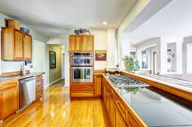 yellow kitchen wood cabinets 7 things you need in your kitchen for the holidays