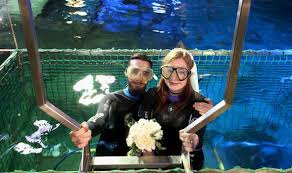 married underwater couples plunge