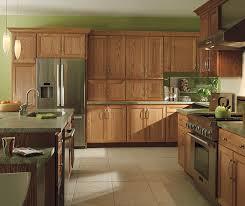 Kitchen With Oak Cabinets Natural Oak Cabinets With Dark Kitchen Island Homecrest