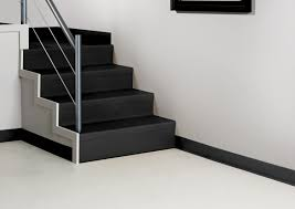 excellent brown oak wooden stair steps combined with grey rubber