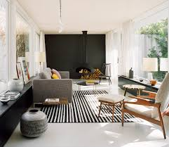 fireplace for living room a hanging fireplace and black accent wall stand out in this modern