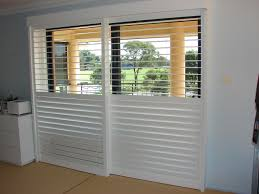 Plantation Shutters On Sliding Patio Doors Roller Shades For Sliding Glass Doors Cafe Shutters Plantation