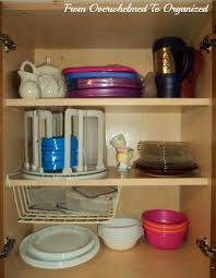 Kitchen Cabinet Plate Organizers Dishes And Glasses Cupboard Organizing Tips From Overwhelmed To