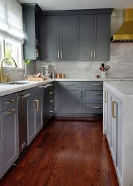 grey kitchen cabinets with brown wood floors gray kitchen cabinets with brass pulls contemporary