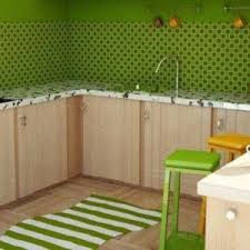 green kitchen tiles backsplash with white cabinets and black
