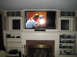 Mounting Tv Over Brick Fireplace by Furniture Pretty Mounted Tv Over A Bricks Fireplace Combined With