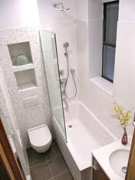 bathroom white tiles shelving and tiny bathrooms