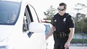 why do cops touch tail lights the reason police officers tap your taillight when they pull you