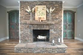 stunning stone fire place room candle scheme wall shelves above