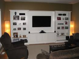 Home Center Decor Circle Entertainment Center Using White Painted Mahogany Wood