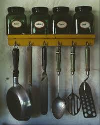 kitchen kitchen utensils hanging below a spice rack nila homes