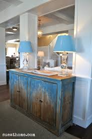 love the stone kitchen hoods design and the blue island with the