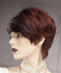 front view of side swept hairstyles short straight formal pixie hairstyle with side swept bangs dark red