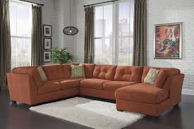 Benchcraft Furniture Delta City 3 Piece Sectional In Orange By Benchcraft Furniture