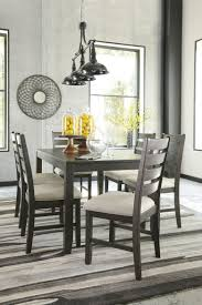 7 dining room set signature design by rokane brown 7 dining room set
