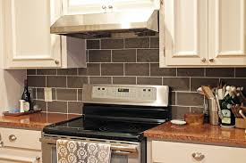 kitchen design with terra cotta red granite countertops white