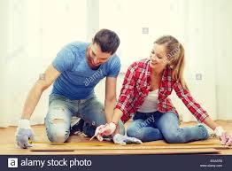 smiling measuring wood flooring stock photo royalty free