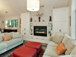 gas fireplace white pendant light built in cabinets cathedral