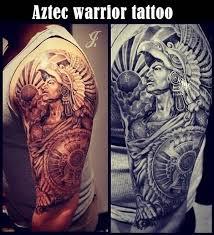 crazy men show tribal aztec warrior tattoo on upper arm