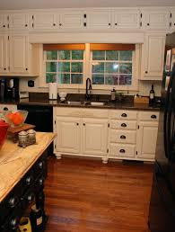 Laminate Flooring Black And White White Wooden Kitchen Cabinet With Black Sink And Black Countertop