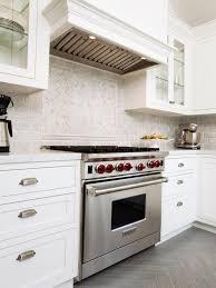 white wooden cabinet hardwood floor backsplash kitchen island