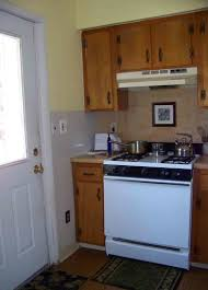 kitchen room stacking two single ovens stove in island with no