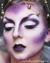 i love this alien inspired makeup but i would change the purples to more silvery grey colours because i think the purple makes it look a bit too fantasy
